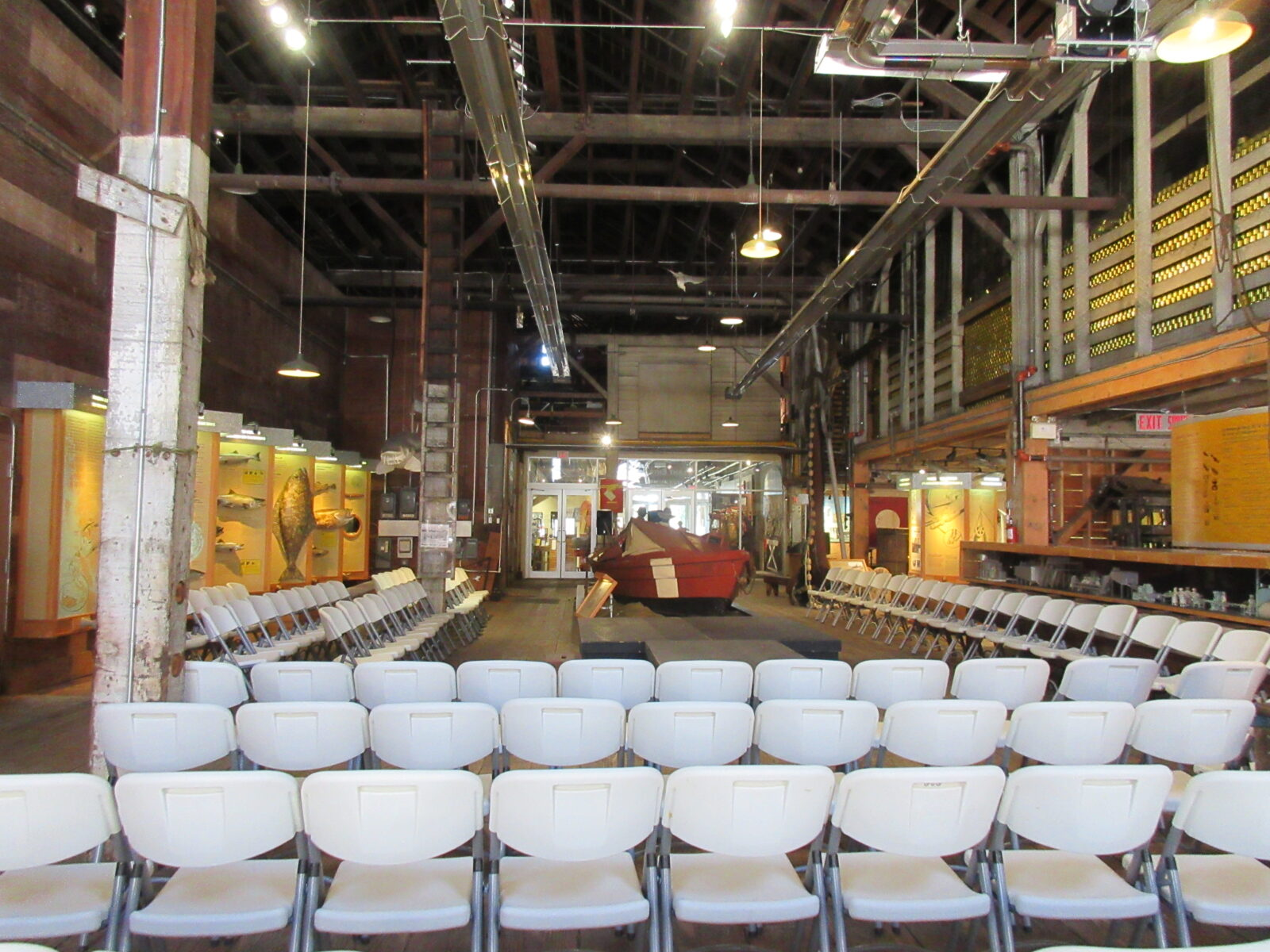Chairs set up for fashion show inside the historic cannery