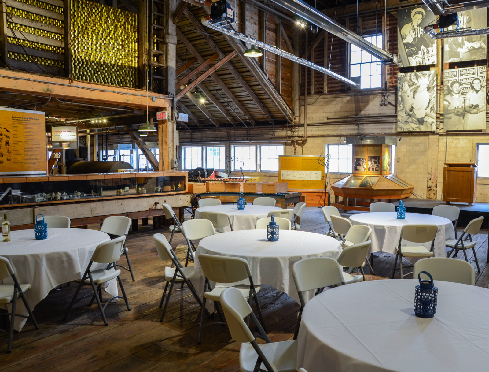 Banquet tables and chairs set up inside historic cannery